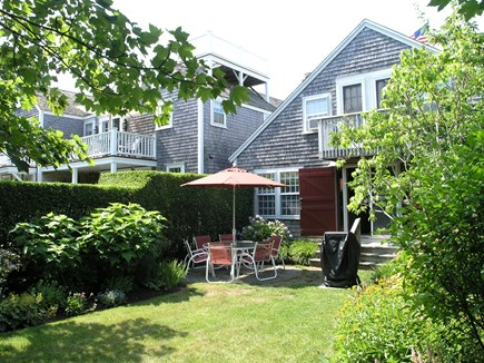 Nantucket town Nantucket vacation rental - Backyard w/ garden, dining area, grill & gate access to Stilldock