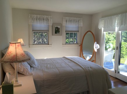 Surfside Nantucket vacation rental - Master bedroom overlooks the deck and private grounds