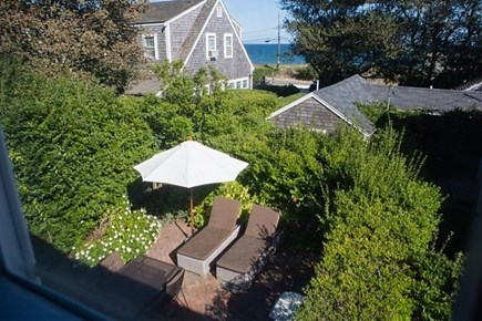 Siasconset, Steps To The Sand Nantucket vacation rental - Patio With Two Chaise Lounges and Large Dining Table