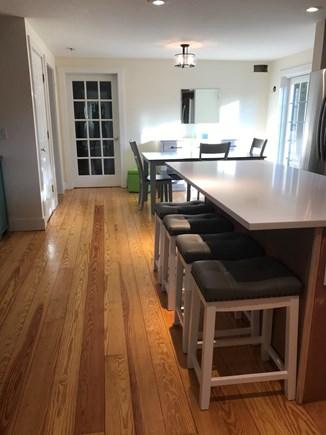 Surfside Nantucket vacation rental - Eat in Kitchen, Dining Area, Door to Den, Hardwood Floors