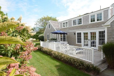 Nantucket town, Lincoln Circle Neighborhood Nantucket vacation rental - Backyard deck with grill and seating for evening dinners.
