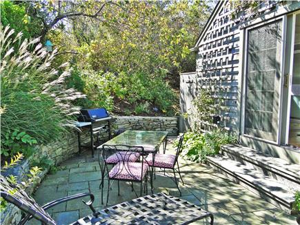 Nantucket town Nantucket vacation rental - Private patio with dining table nestled in hillside
