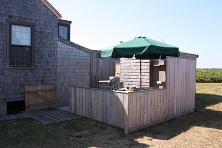 Madequecham Nantucket vacation rental - Outdoor breakfast nook with view of water.