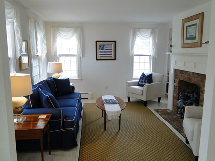 Mid-island, Naushop Nantucket vacation rental - Living room with fireplace and seating