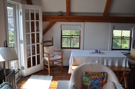 Dionis Nantucket vacation rental - Northwest corner upper level with dining and door to deck