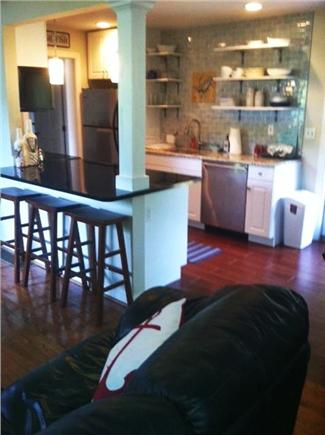 Mid-island, Naushop Nantucket vacation rental - Living Room opens to Dining Area with slider to covered patio